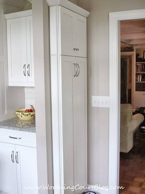 Narrow kitchen cabinet command center added to end of a bank of cabinets