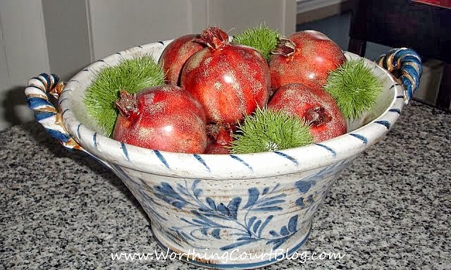 A bowl of pomegranates in the kitchen