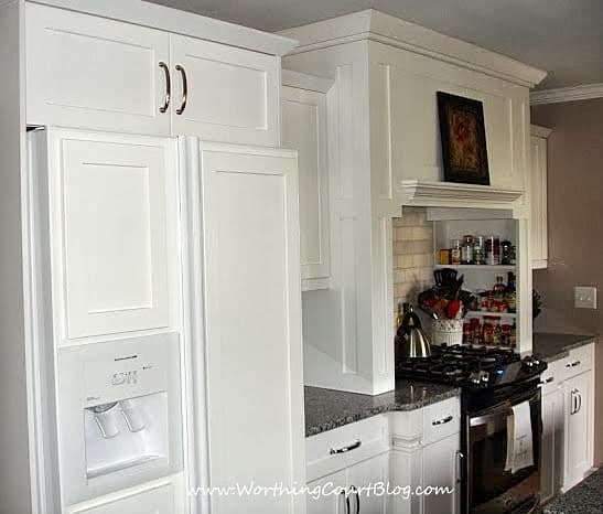 Custom kitchen range hood with built-in spice shelves