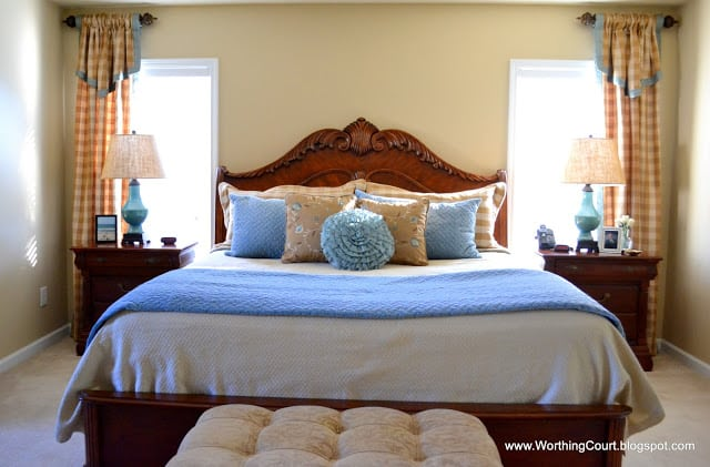 Master bedroom bed and drapery panels
