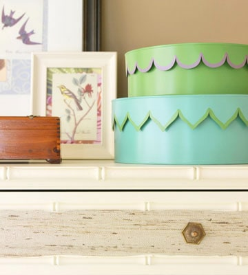 Loads of tips for how to organize, decorate and add style to a small bedroom. Pretty boxes, stacked together, are a great way to store smaller items in a stylish way.