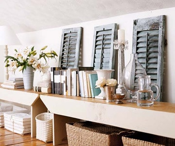Loads of tips for how to organize, decorate and add style to a small bedroom. Don't let a knee wall be get you down (pun intended!). Add a bench for display space. The empty space below becomes a great place for pretty storage baskets.