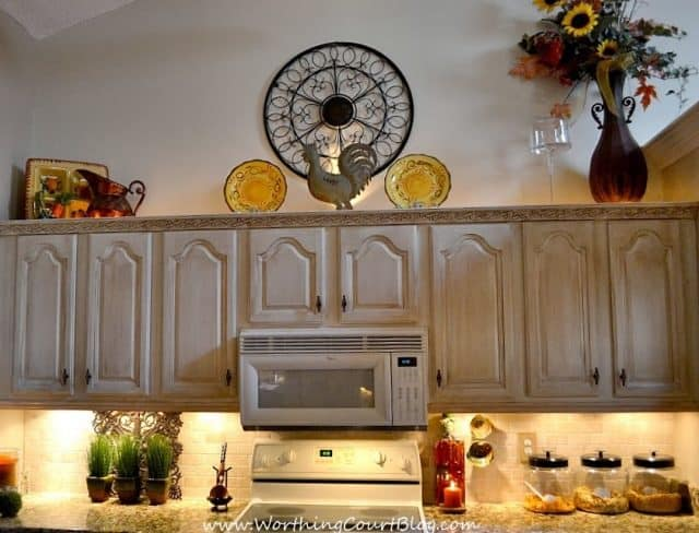DIY French Country Kitchen Makeover: Rope lighting added above the cabinets by drilling through the top of the cabinets to access the electric outlet for the microwave