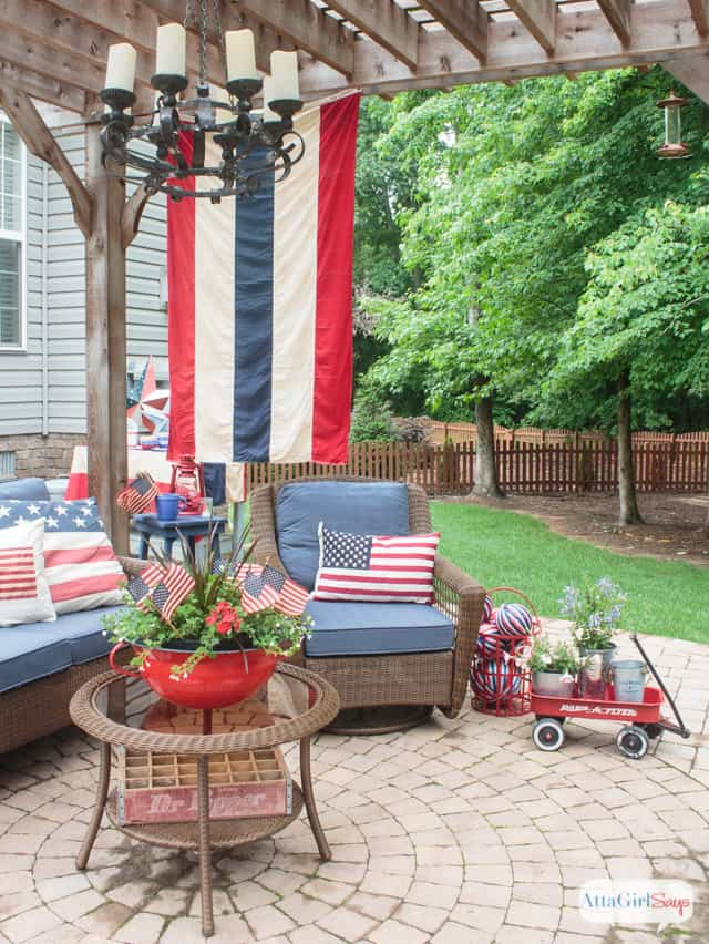 outdoor seating area with red white and blue decor