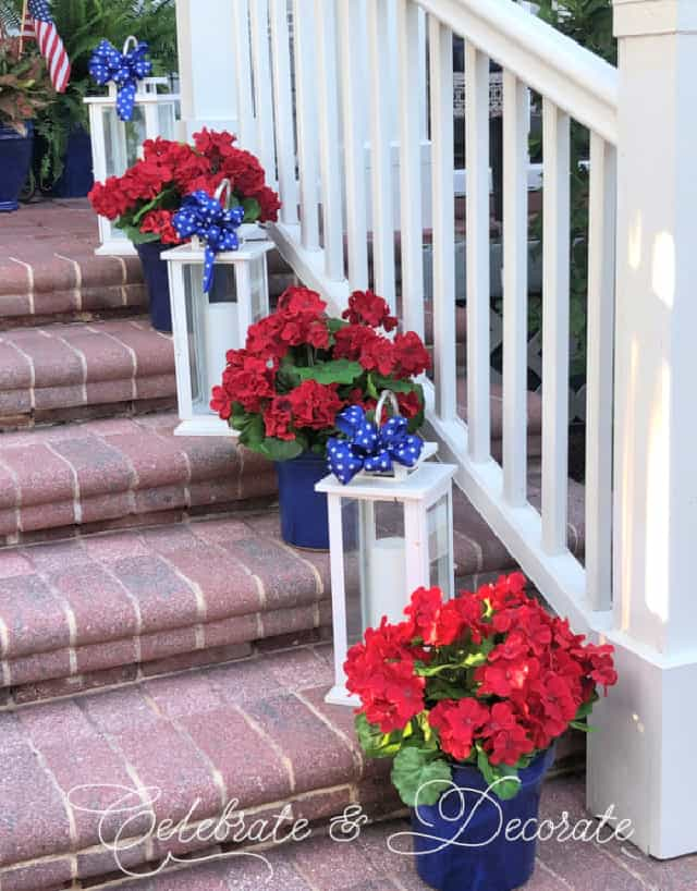 red brick steps with white lanterns and blue and red flowers