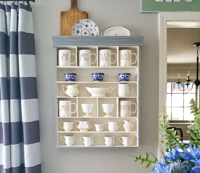 wall shelf with blue and white dishes