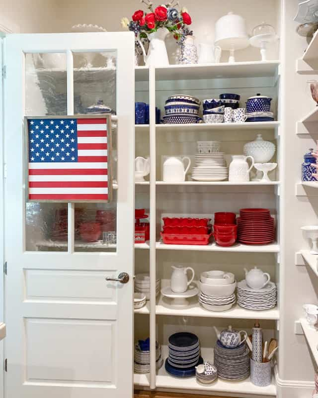 red white and blue dishes in a white pantry