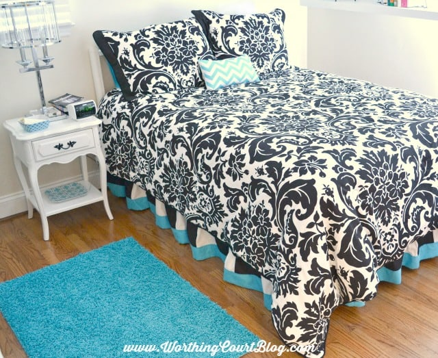Use a coordinating sheet to add trim to a bed skirt to make it pop