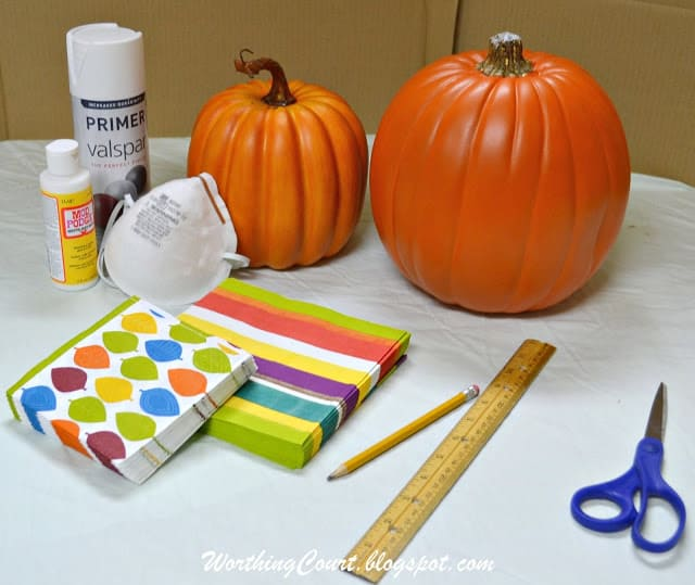 Supplies used for decoupaging decorative napkins onto faux pumpkins