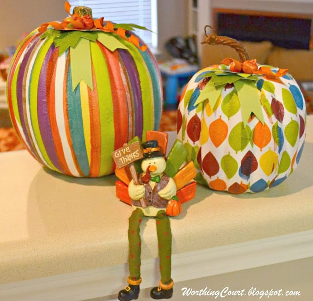 Completed faux pumpkins that have decorative napkin strips applied with ModPodge