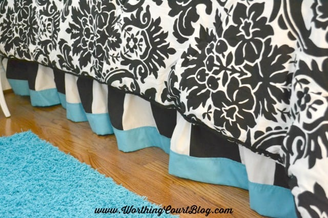 Use a matching sheet to add a band to a ready-made bed skirt.  The customized look will make it look like it came from a designer's workroom.