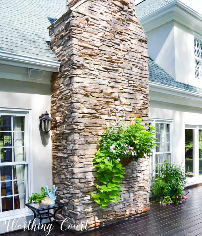 outdoor planter hanging from rock chimney