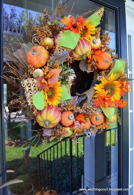 Pumpkin wreath with bits of raffia ribbon and burlap ribbon added