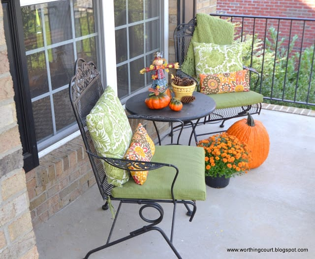 Front porch sitting area with Fall decorations