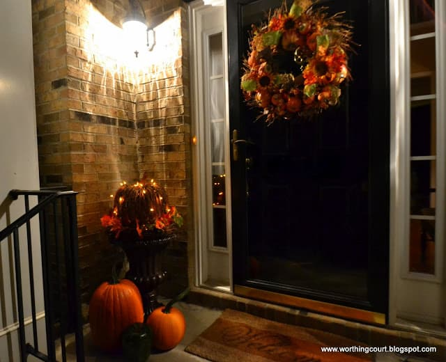 Fall porch decorations at night