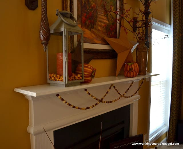 A garland made from wooden beads strung on fishing line is a perfect addition to a Fall mantle