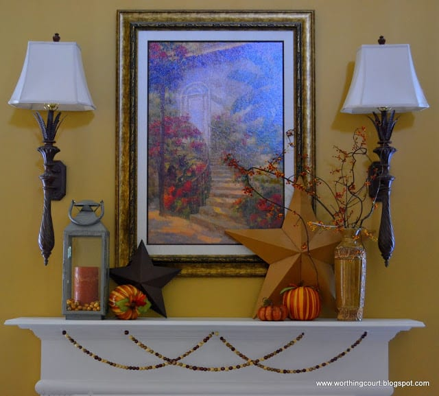 A mantle filled with Fall decorations