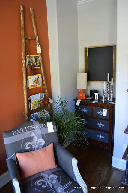 ladder used as a magazine rack in this gray and burnt orange office via Worthing Court blog