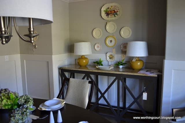 vintage plates above industrial sideboard via Worthing Court blog