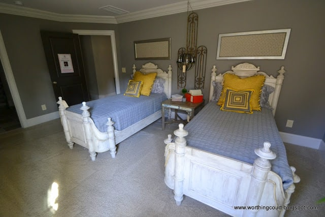twin beds, yellow and gray bedroom, framed fabric, pillows and light fixture via Worthing Court blog