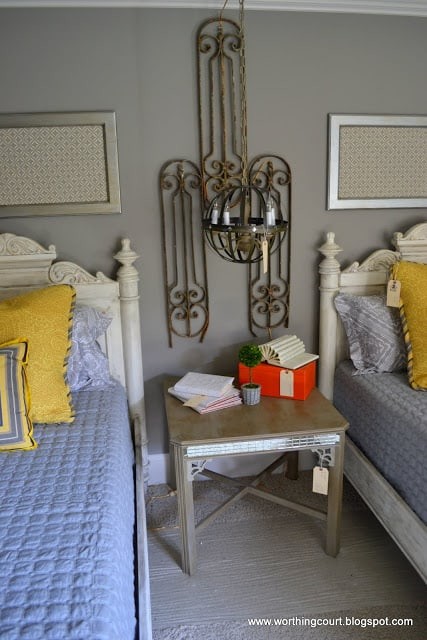 yellow and gray bedroom, orb light fixture, vintage metall wall art via Worthing Court blog