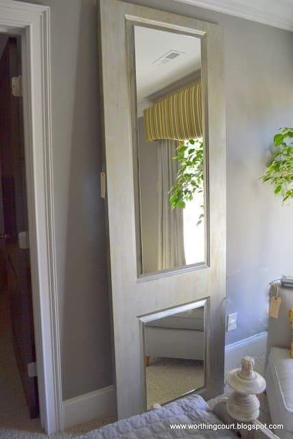 mirrors attached to vintage door leaned against the wall via Worthing Court blog