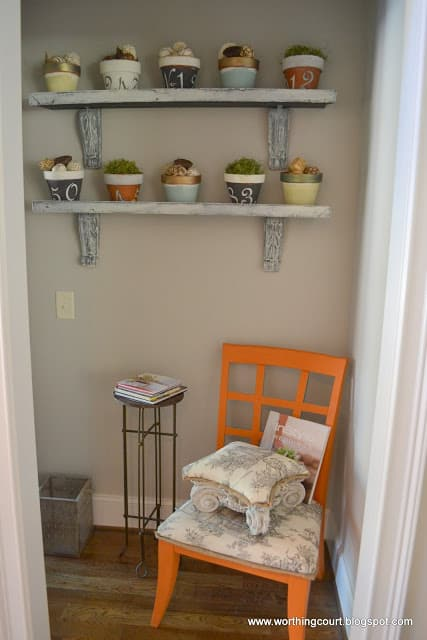 painted clay pots on shelves via Worthing Court blog