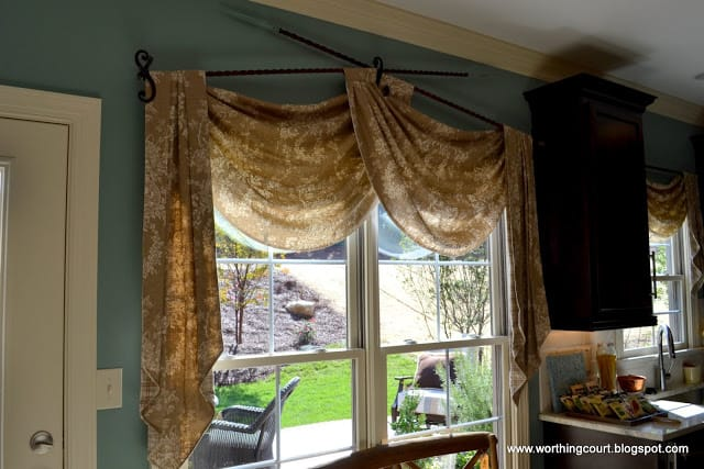 swag and jabot window treatment with iron hardware via Worthing Court blog