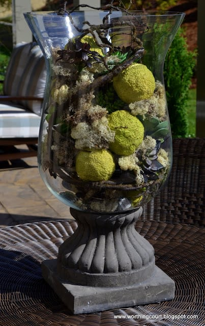 Urn filled with natural elements via Worthing Court blog
