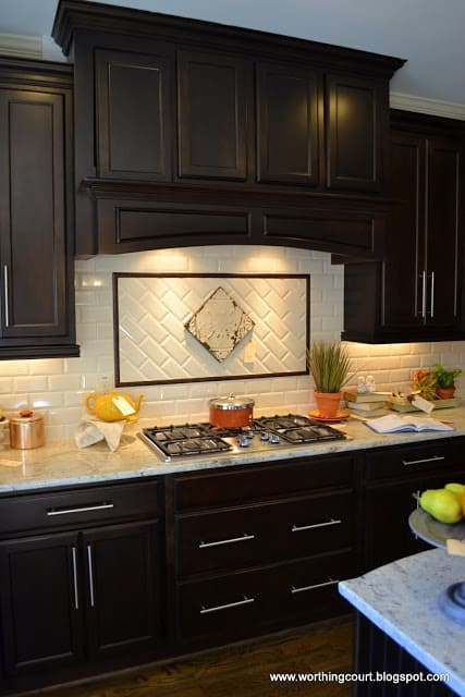 dark kitchen cabinetry via Worthing Court blog