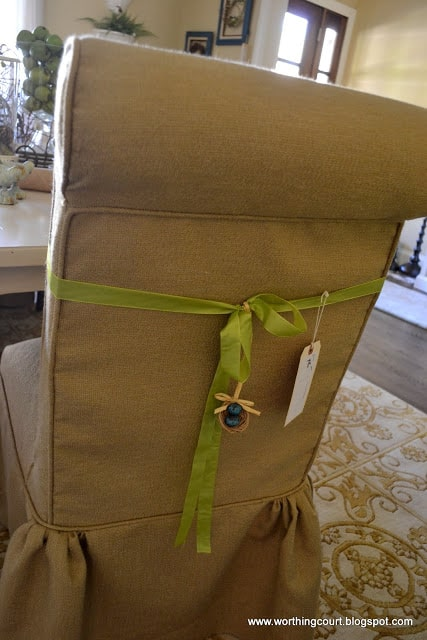 dining room chair slipcovered in linen with a ribbon accent and birds nest embellishment via Worthing Court blog