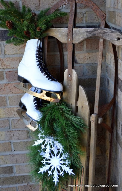 A front porch is a great place to display a vintage sled as part of winter decor