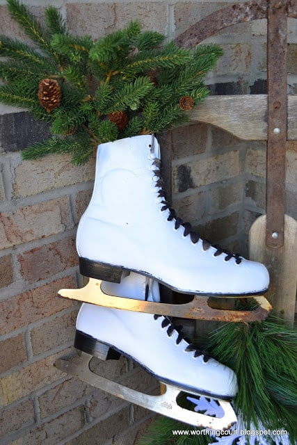 Paint old black skates white for displaying on a winter front porch