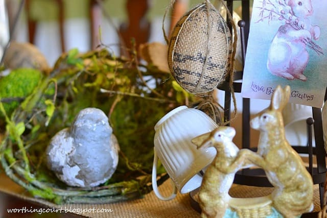 A chippy bird and faux bird nest are part of an Easter centerpiece
