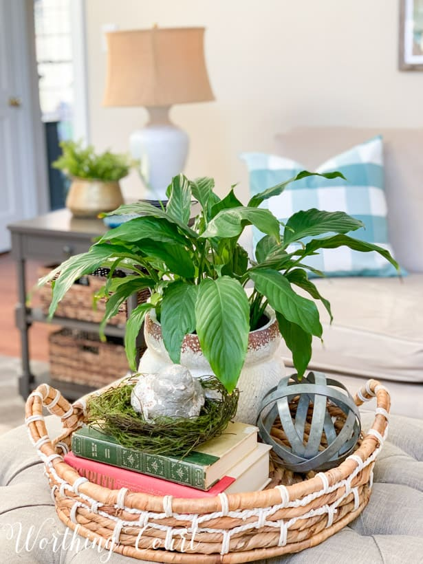 spring coffee table vignette in a round woven tray