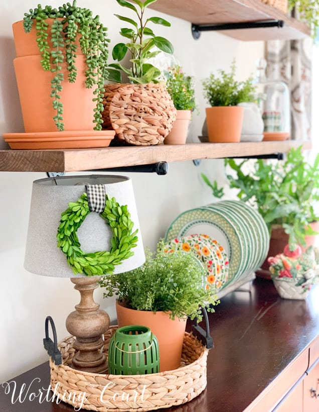 spring decor using a variety of terra cotta pots