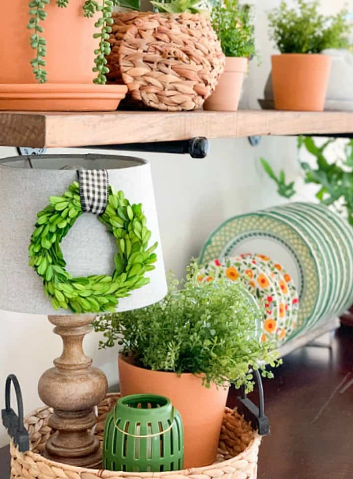 terra cotta pots and spring dishes on shelves