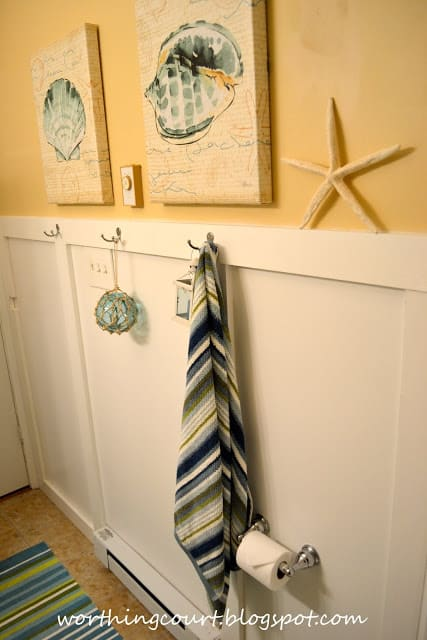 There is a starfish and towel on the wall.