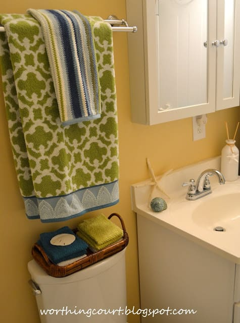 Green and blue and white towels in the bathroom.