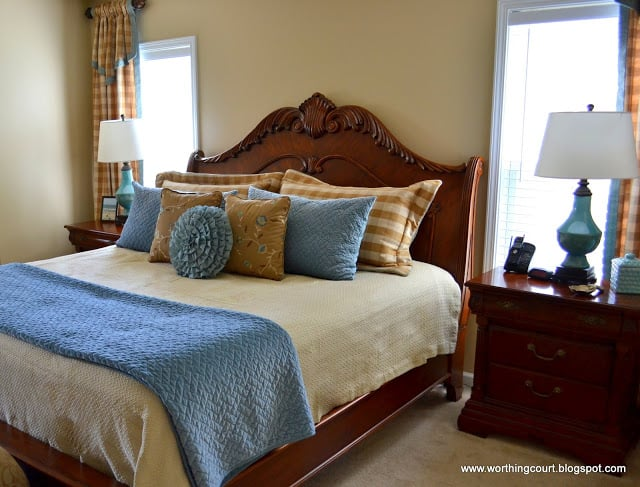 blue and brown master bedroom with buffalo checked draperies via Worthing Court blog