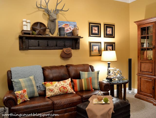 Top part of a vintage mantle and faux deer head in a rustic family room