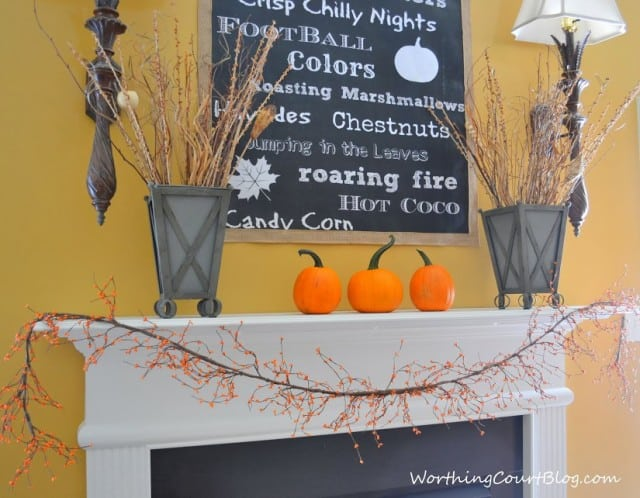 Worthing Court: Fall mantel with galvanized metal containers filled with natural elements