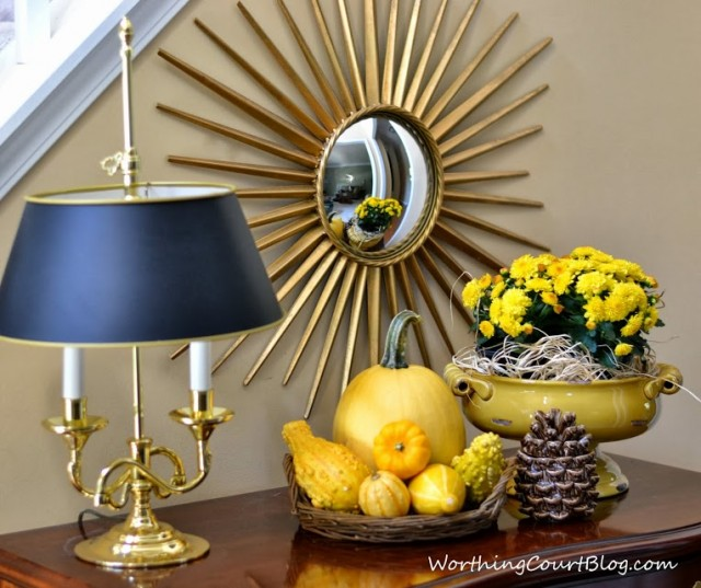 Worthing Court: fall foyer vignette with yellow pumpkins, gourds and mums