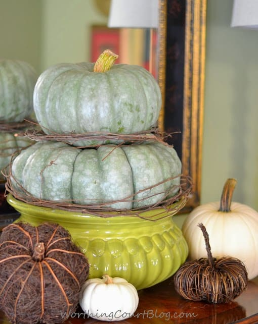 Worthing Court: Fall vignette with an heirloom pumpkin topiary mixed with white and twiggy pumpkins