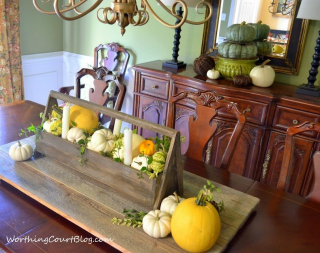 Worthing Court: fall centerpiece and sideboard vignetter with yellow, white and twiggy pumpkins