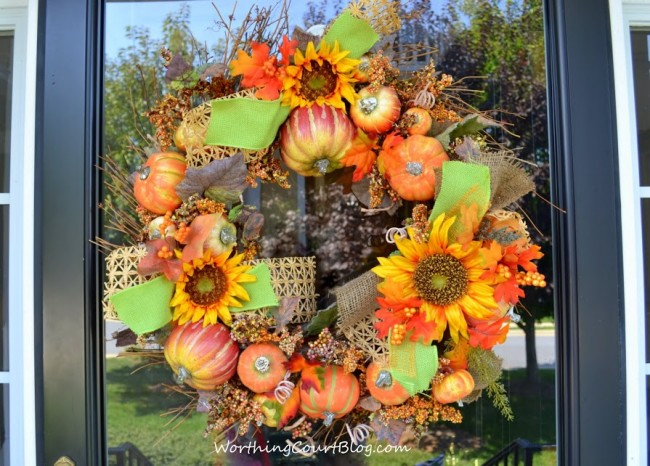 Fall wreath with pumpkins and sunflowers