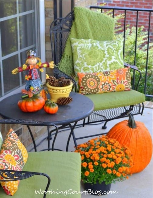 Front porch sitting area decorated for Fall