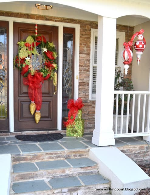 Worthing Court: Christmas wreath and oversized ornaments grace the front porch