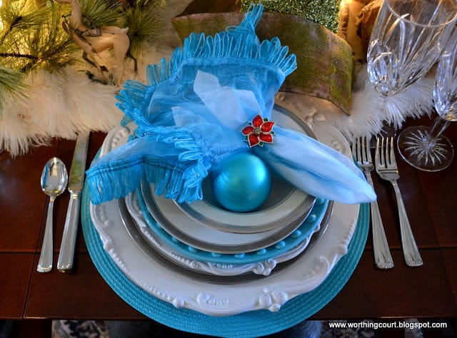 Worthing Court: Turquoise and white Christmas place setting with a pop of red