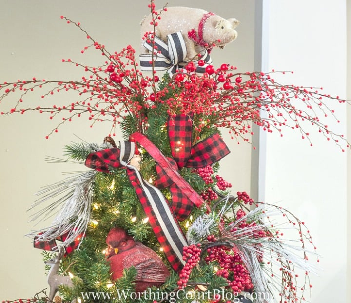 Christmas tree topper with red berries and ribbon